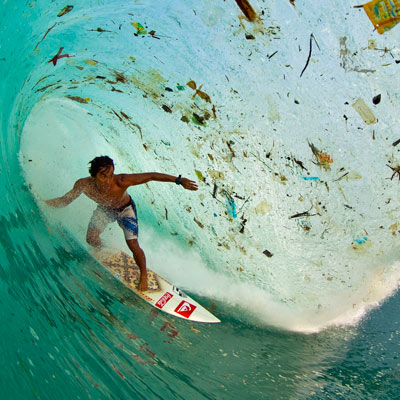 Surfing among plastic in Bali - photo by Zak Noyle